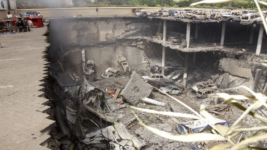 September 26, 2013: This photo released by the Kenya Presidency shows the collapsed upper car park of the Westgate Mall in Nairobi, Kenya.