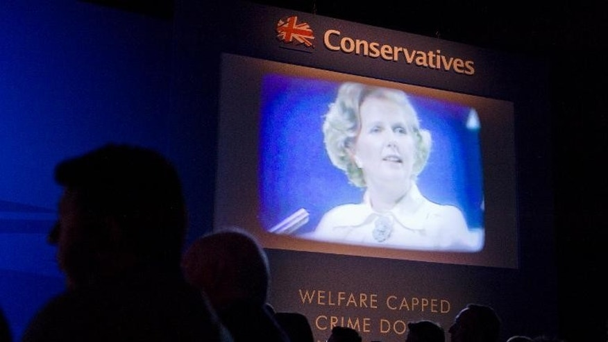 Delegates watch a tribute film to Margaret Thatcher on the first day of the Conservative Party Conference in Manchester on September 29, 2013.