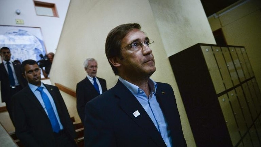 Portuguese Prime Minister Pedro Passos Coelho leaves after voting in Massama on September 29, 2013