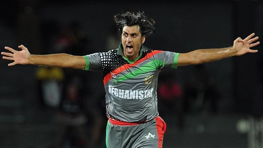 Afghanistan cricketer Shapoor Zadran celebrates after dismissing England's Craig Kieswetter during the ICC Twenty20 Cricket World Cup match at The R. Premadasa Stadium in Colombo on September 21, 2012