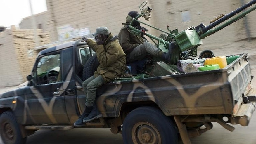 Malian soldiers patrol in the streets of Timbuktu on February 1, 2013