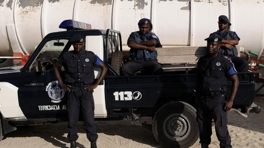 Angolan police officers stand guard in Luanda on January 16, 2010