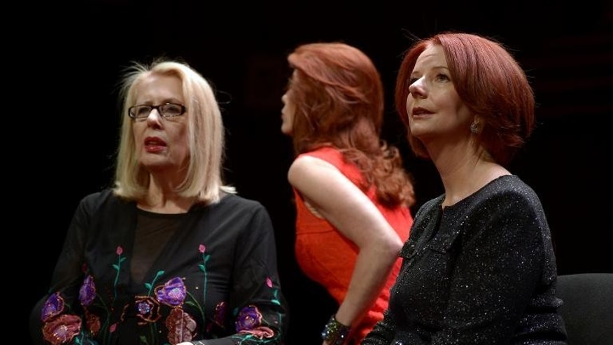 Australia's former prime minister Julia Gillard (R) talks with author Anne Summers (L) prior to a televised interview at the Sydney Opera House on September 30, 2013