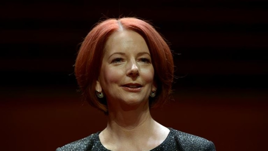 Australia's former prime minister Julia Gillard poses for a photographs prior to a televised interview in front of a live audience at the Sydney Opera House on September 30, 2013
