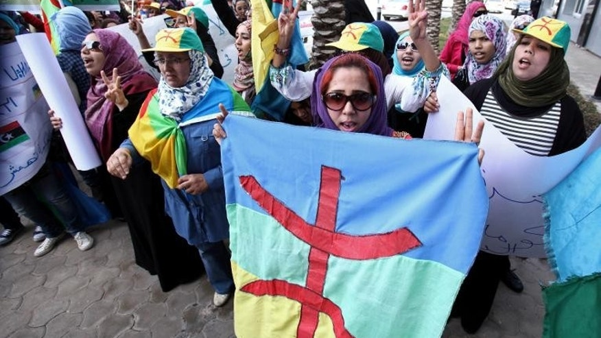 Libyan Amazigh Berbers protest outside the prime minister's office in Tripoli on November 27, 2011