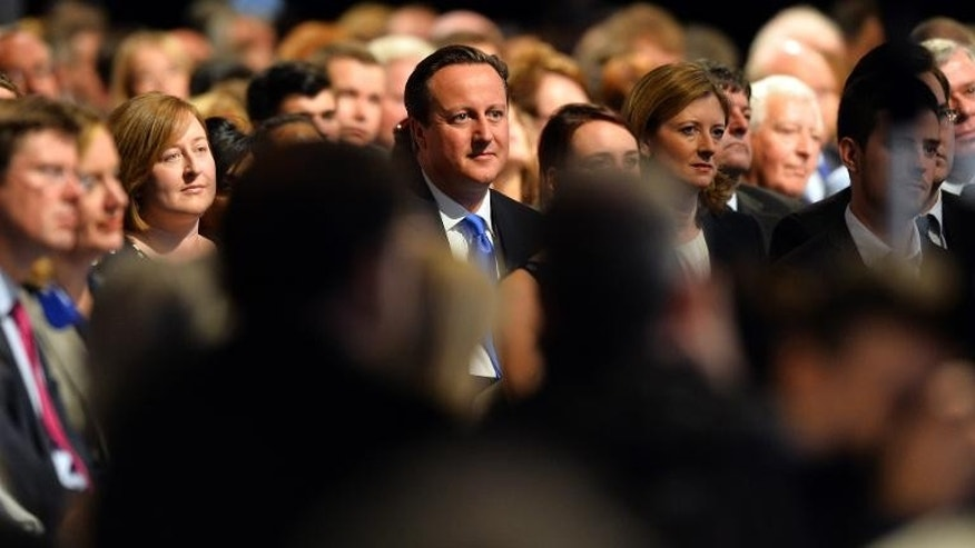 Prime Minister David Cameron sits in the audience during the Conservative Party Conference in Manchester, on September 30, 2013