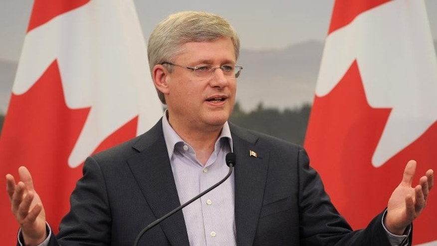 Canada's Prime Minister Stephen Harper speaks near Enniskillen in Northern Ireland on June 18, 2013.
