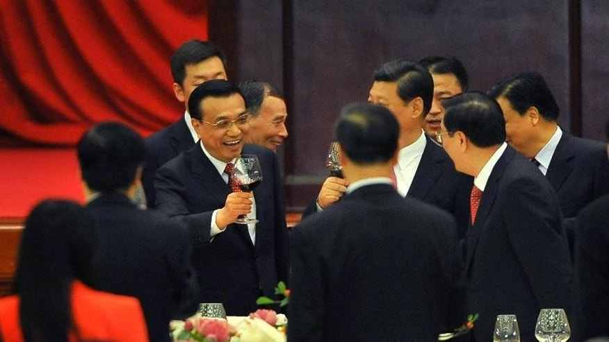China's Premier Li Keqiang (L) raises his glass during the 64th National Day reception at the Great Hall of the People in Beijing on September 30, 2013