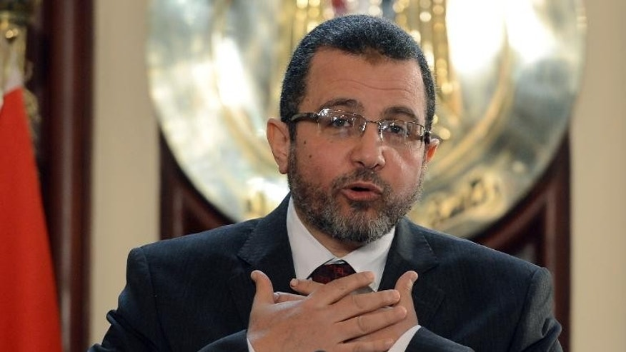 Former Egyptian Prime Minister Hisham Qandil gives a press conference in Cairo on December 30, 2012