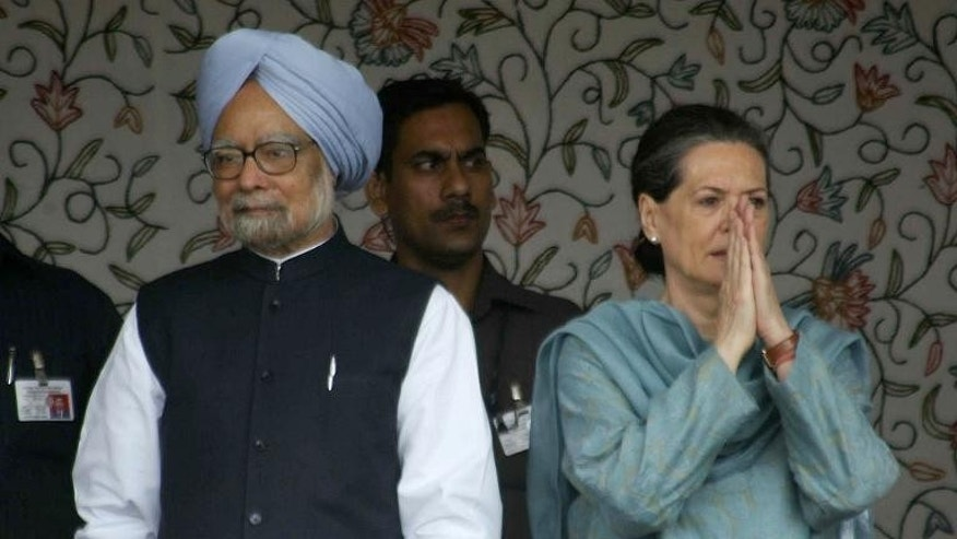 Indian Prime Minister Manmohan Singh (left) and Congress Party leader Sonia Gandhi attend a ceremony in the Kishtwar district of Jammu, on June 25, 2013