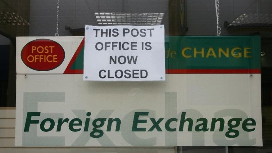 A sign indicating the closure of a Post Office in Aldershot, Hampshire on October 01, 2008
