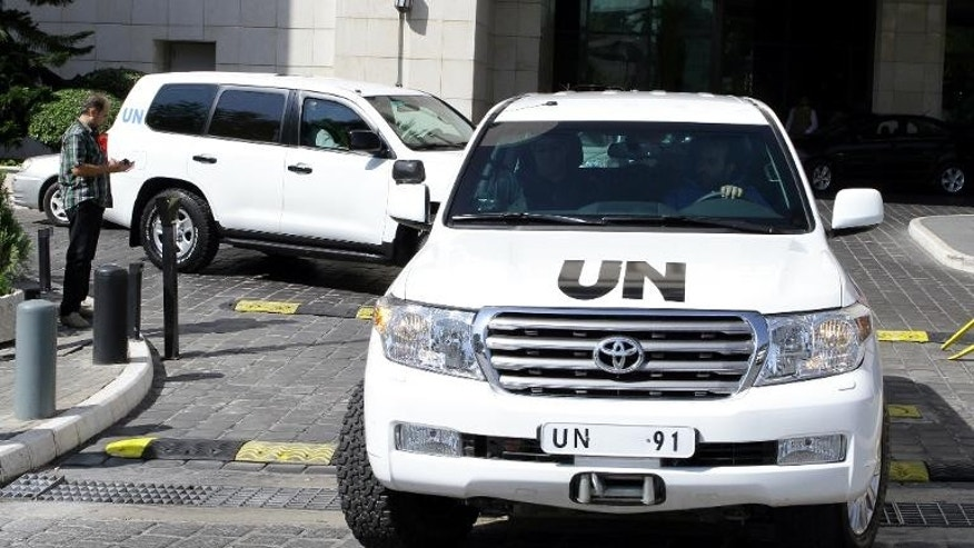 A convoy of United Nations vehicles carrying chemical weapons experts, leaves a hotel in the Syrian capital Damascus, on September 29, 2013