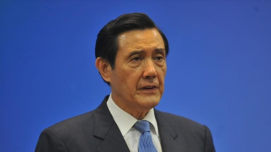 Taiwan's President Ma Ying-jeou speaks during a press conference at the headquarters of the ruling Kuomintang (KMT) party in Taipei, on September 11, 2013