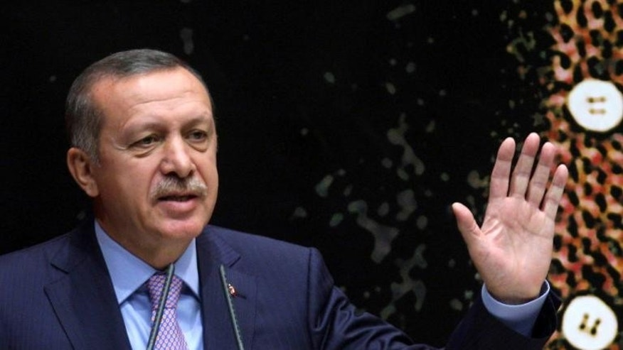 Turkish Prime Minister Recep Tayyip Erdogan gestures as he speaks during a meeting of his ruling Justice and Development Party (AKP) in Ankara, on September 20, 2013