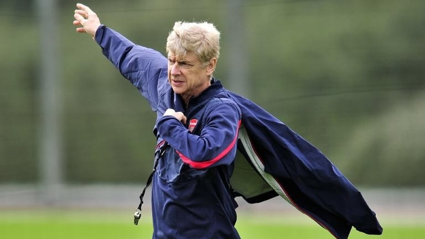 Arsenal's French manager Arsene Wenger is pictured during a team training session at Arsenal's London Colney training ground in north London on September 30, 2013