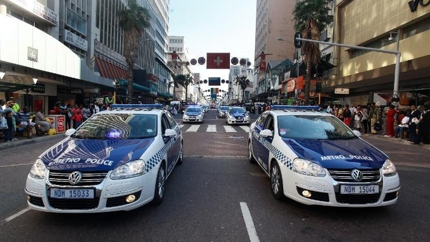 Members of the Metro Police drive their cars in Durban on July 8, 2010