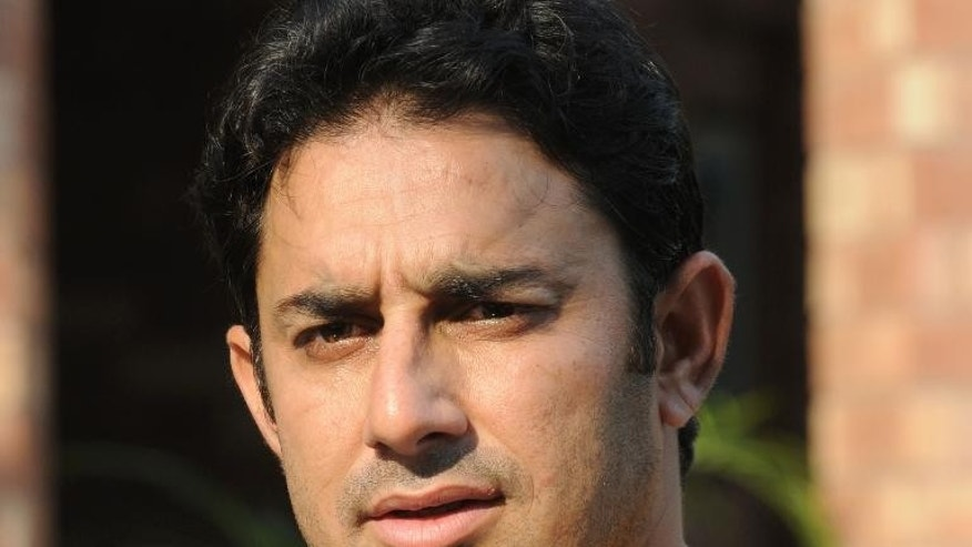 Pakistani cricketer Saeed Ajmal speaks with media representatives after a training camp in Lahore on October 1, 2013