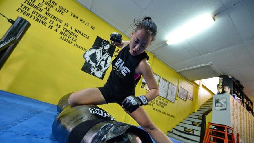 Sherilyn Lim, ONE FC mixed martial artist, pictured during a training session at a gymnasium in Singapore on September 27, 2013