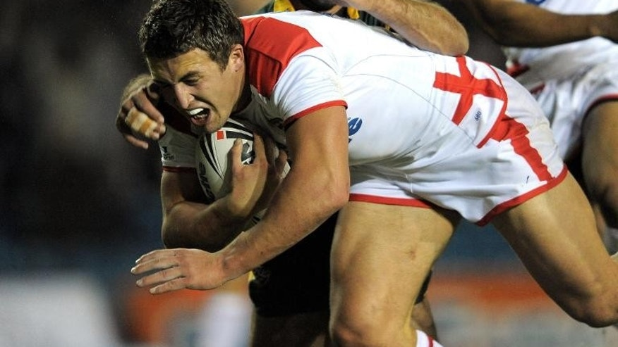 England's Sam Burgess (left) evades a tackle from Australia's Johnathan Thurston during a rugby league international at Elland Road, northern England, on November 14, 2009