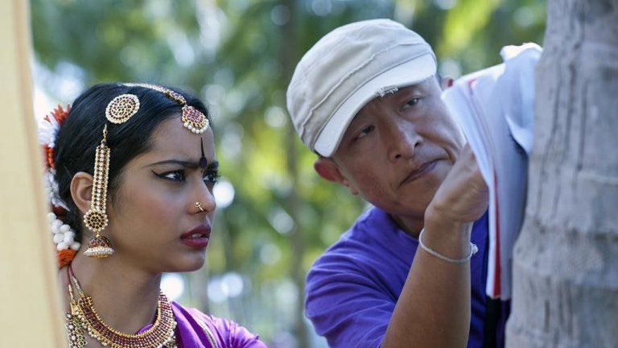 "Handout photo shows director Khyentse Norbu (R) on the set of Bhutanese film ""Vara: A Blessing"""