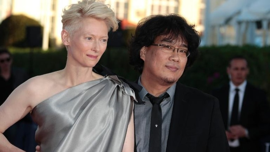 Actress Tilda Swinton and South Korean director Bong Joon-Ho at the at the Deauville film festival in France on September 7, 2013
