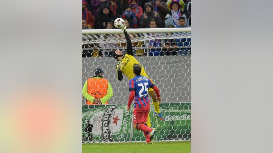 Bucharest's Italian striker Federico Piovaccari (front) watches as Chelsea's Czech goalkeeper Petr Cech makes a save at National Arena Stadium in Bucharest, Romania on October 1, 2013