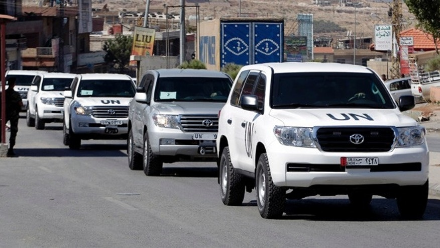 Oct. 1, 2013: A convoy of inspectors from the Organization for the Prohibition of Chemical Weapons prepares to cross into Syria at the Lebanese border crossing point of Masnaa, eastern Bekaa Valley, Lebanon. An advance group of 20 inspectors from a Netherlands-based chemical weapons watchdog arrived in Syria on Tuesday to begin their complex mission of finding, dismantling and ultimately destroying an estimated 1,000-ton chemical arsenal.