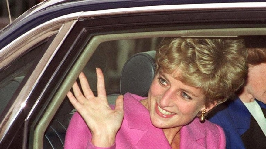 Diana, Princess of Wales waves to the crowd as she arrives at the Cite de la Musique at La Villette in Paris on November 14, 1992