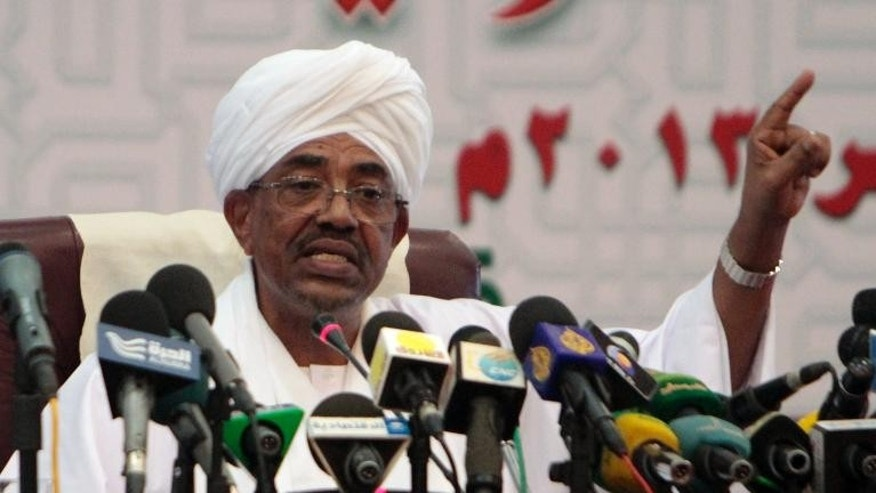 Sudanese President Omar al-Bashir speaks during a press conference in Khartoum on September 22, 2013