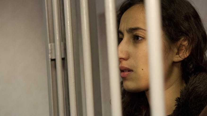 Greenpeace activist Faiza Oulahsen from the Netherlands at the Leninsky district Court of Murmansk, in a photo released on September 29, 2013