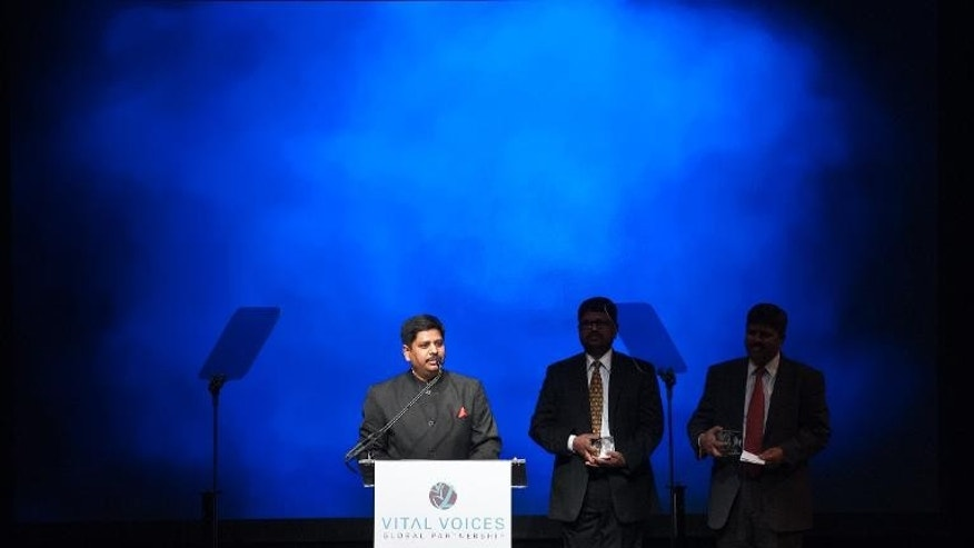 Rishi Kant of Shakti Vahini, an NGO that works for the rights of women and children in India and his two brothers accept their Solidarity award during the Vital Voices Global Awards ceremony at the Kennedy Center in Washington on April 2, 2013