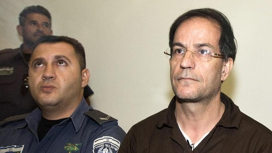 Ali Mansouri, 58, arrested at Israel's Ben Gurion Airport on suspicion of espionage, arrives at the Petah Tikva District Court on the first day of his trial on September 30, 2013