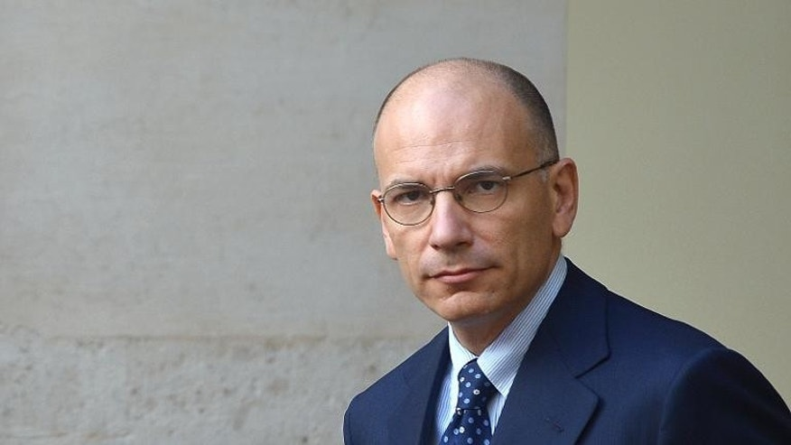 Italian Prime Minister Enrico Letta waits for the arrival of Somalia's President Hassan Sheikh Mohamud at Chigi Palace in Rome on September 18, 2013