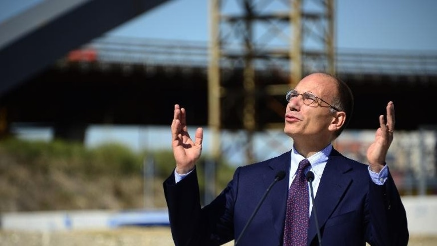 "Italian Prime Minister Enrico Letta gives a press conference on the construction site of the future ""Exposition Universelle 2015 "" on September 13, 2013 in Rho, Milan"