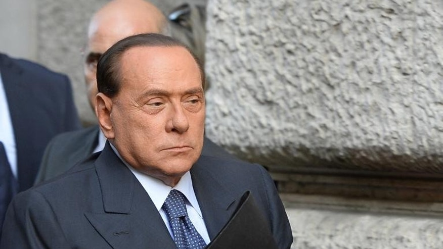 Italy's former prime minister Silvio Berlusconi smiles as he arrives for a meeting on September 30, 2013 in Rome