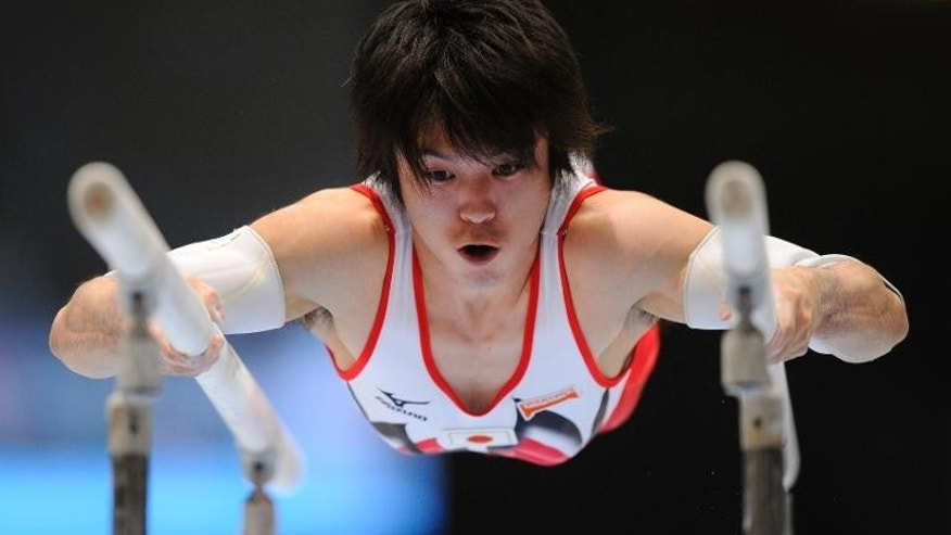 Japan's Kohei Uchimura competes on parallel bars during at the world gymnastics championships in Antwerp, on September 30, 2013