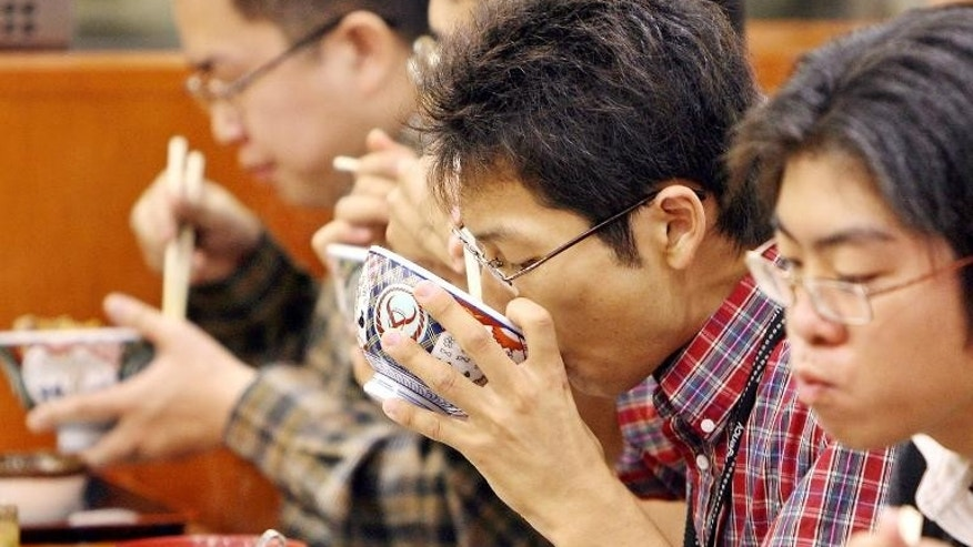 Illustration: customers dine at a Yoshinoya fast food restaurant in Tokyo. The company says it will start farming produce in Fukushima