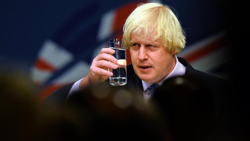 London Mayor Boris Johnson acknowledges the applause from delegates after addressing the annual Conservative Party Conference in Manchester, on October 1, 2013