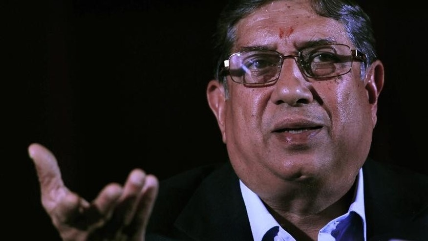 President of the Board of Control for Cricket in India (BCCI) N. Srinivasan gestures as he addresses a press conference in Kolkata on May 26, 2013