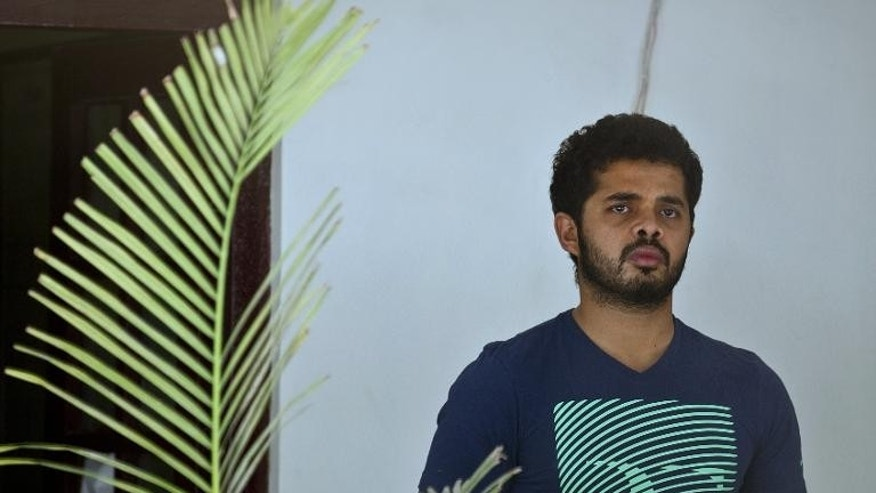 Indian cricketer Shanthakumaran Sreesanth pictured before being taken to court in New Delhi on May 28, 2013