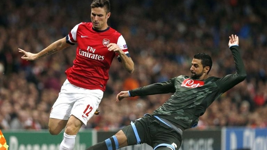 Arsenal striker Olivier Giroud (L) and Napoli's Miguel Britos during the Champions League match in London on October 1, 2013