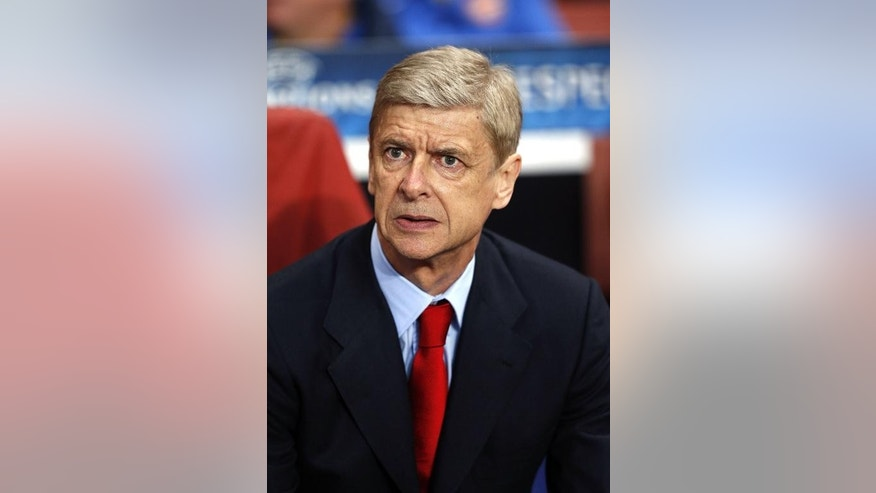 Arsenal's French manager Arsene Wenger waits for the start of the match against SSC Napoli at the Emirates Stadium, North London, on October 1, 2013