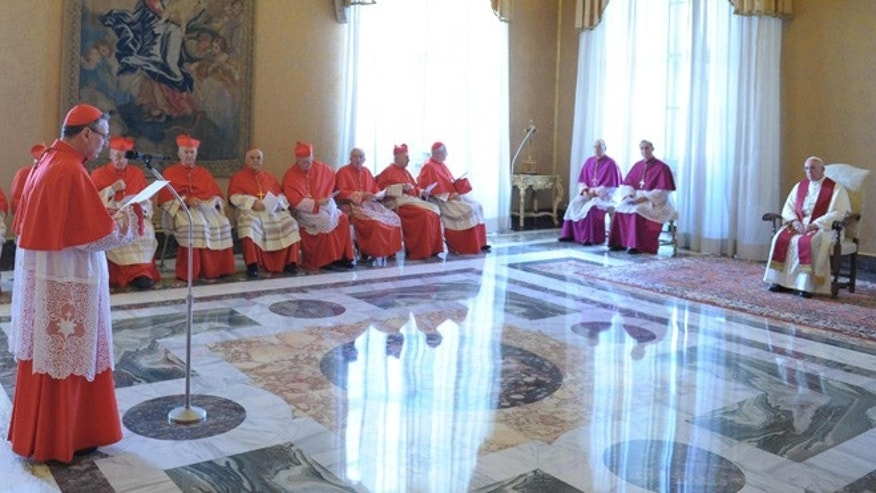 Sept. 30, 2013: In this picture provided by the Vatican newspaper L'Osservatore Romano, Pope Francis listens to a cardinal during a consistory at the Vatican.