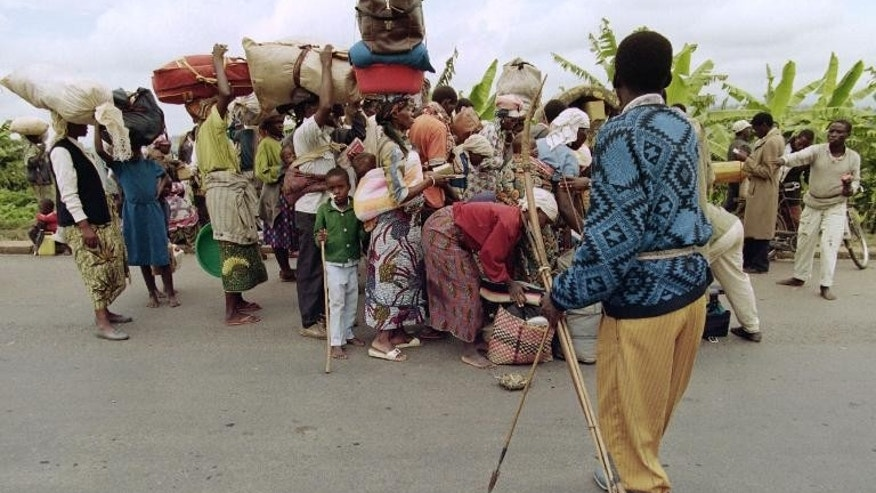 Hutu militiamen control fleeing Rwandans at a checkpoint south of Kigali on May 27, 1994