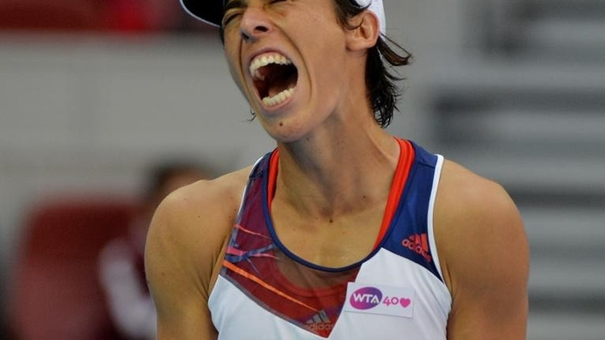 Italy's Francesca Schiavone reacts after missing a shot against Serena Williams of the United States during their women's singles match at the China Open in Beijing on October 1, 2013. Williams won 6-4, 7-5