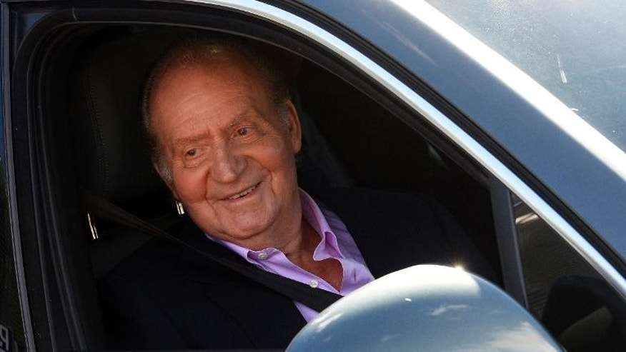 Spain's King Juan Carlos leave the Quiron University Hospital in Madrid on October 1, 2013