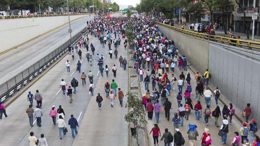 Teachers on strike block a freeway in Mexico City during a protest against educational reforms proposed by President Enrique Pena Nieto, on September 11, 2013