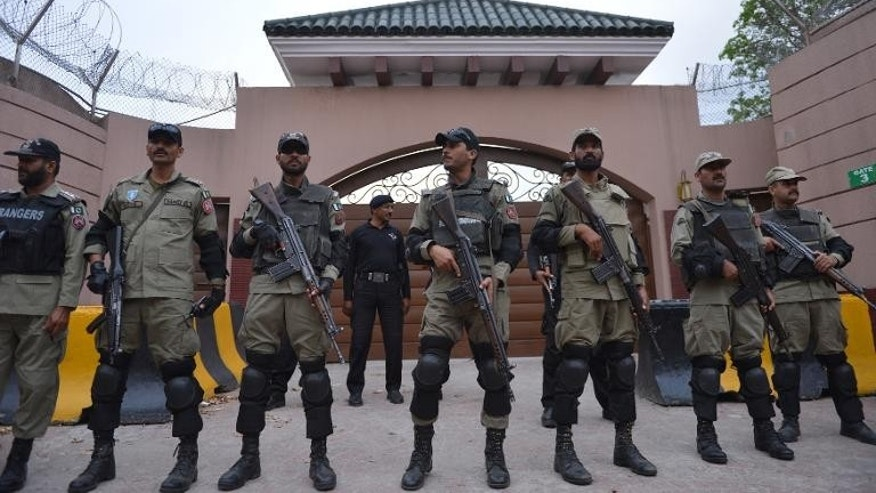 Pakistani soldiers stand guard outside the residence of former president Pervez Musharraf in Islamabad in April 2013