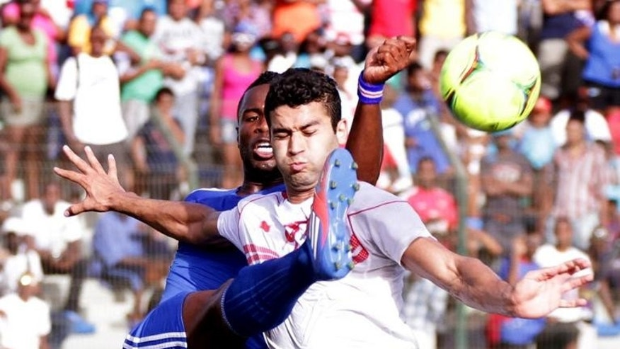Tunisian stirker Hamdi Harbaoui vies with Cape Verdean defender Fernando Varela (left) in Praia Stadium during qualifying match for the 2014 FIFA World Cup on June 9, 2012