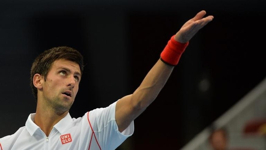 Serbia's Novak Djokovic serves during his China Open match against Lukas Rosol in Beijing on October 1, 2013